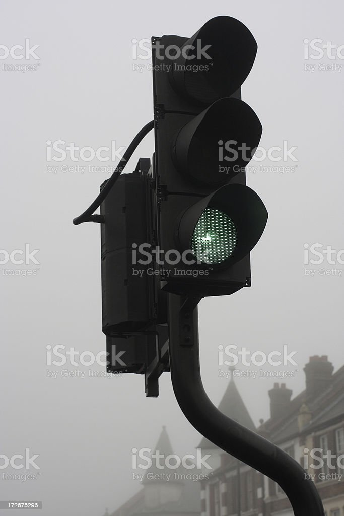 Green for go on foggy day in London town royalty-free stock photo