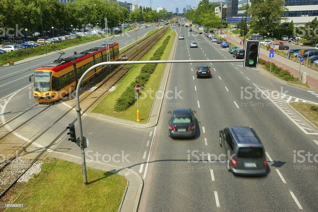 Traffic lights luminous in green and cars, Urban scene royalty-free stock photo