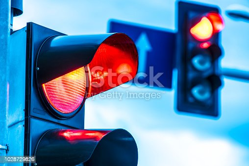 Traffic lights over urban intersection.