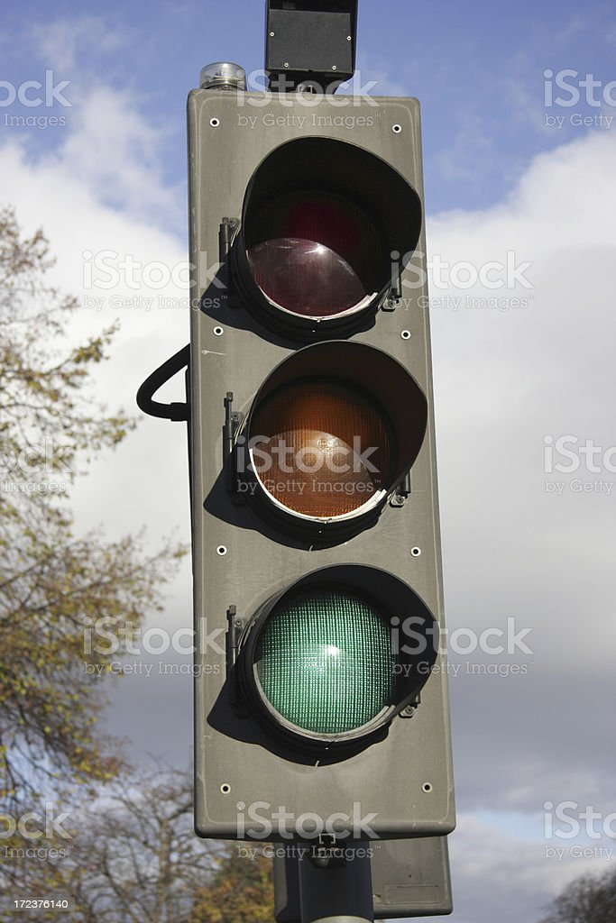 Go traffic lights set to green royalty-free stock photo