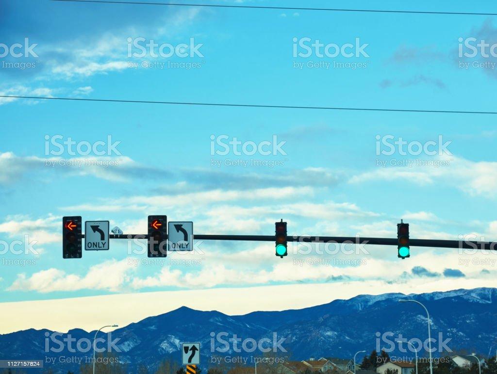 Traffic lights shot in early morning light showing green light