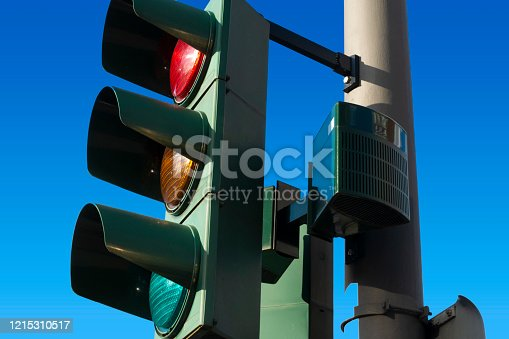 Traffic lights up close against clear blue sky