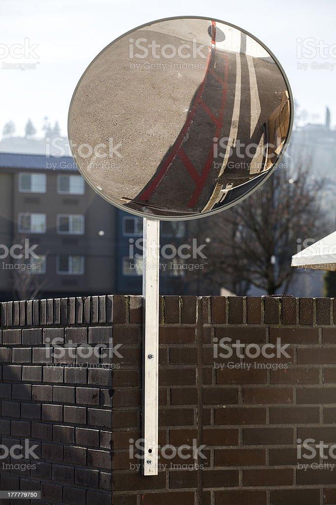 Traffic Mirror Mounted on Brick Wall royalty-free stock photo