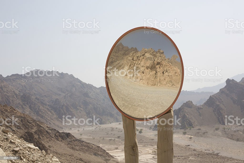 Traffic mirror reflects the mountain region of Musandam, Oman stock photo