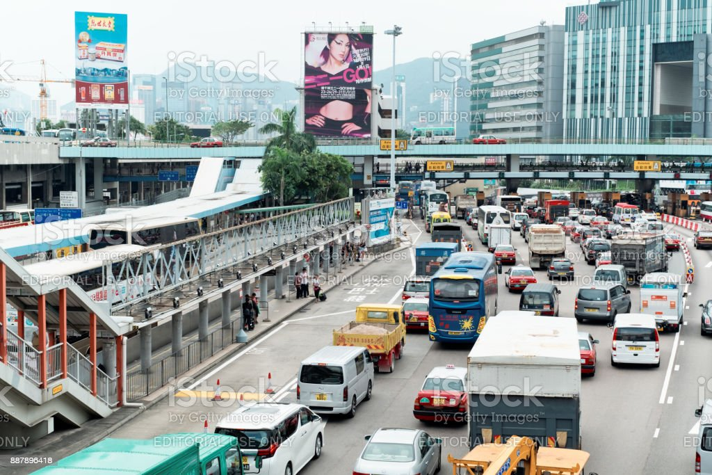 Traffic moves slowly along a busy road in Kowloon, Hong Kong. stock photo
