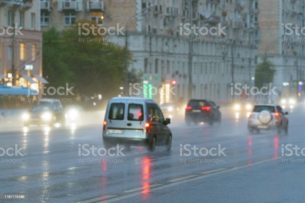 Blurred motion on the city highway in rain during day. Big traffic....