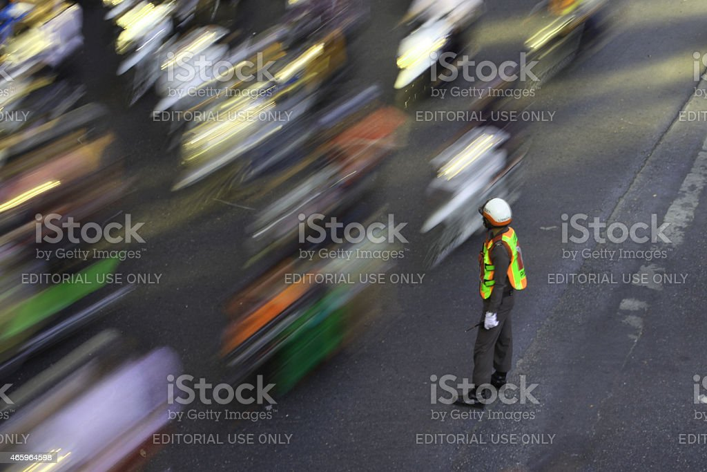 Traffic officer, controlling traffic on busy street. stock photo