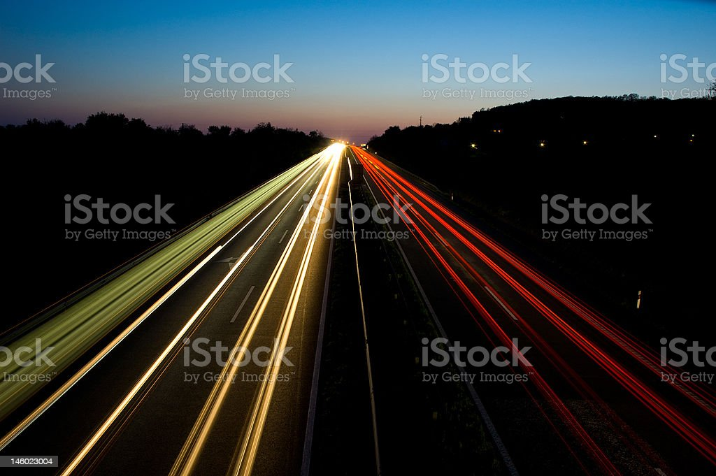 Traffic on a highway at night royalty-free stock photo