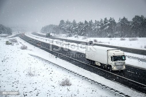 1127834626 istock photo Traffic on a highway during a snow blizzard in winter 894346680