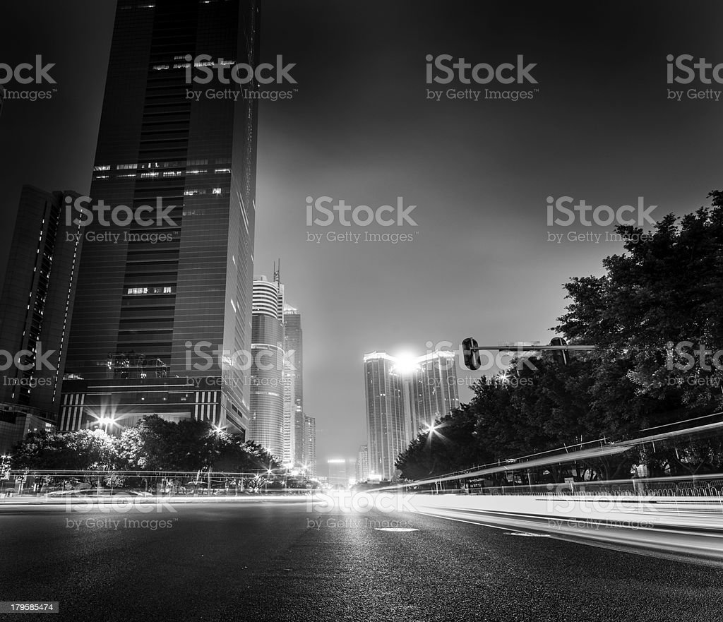 Traffic on a street at night black and white royalty-free stock photo
