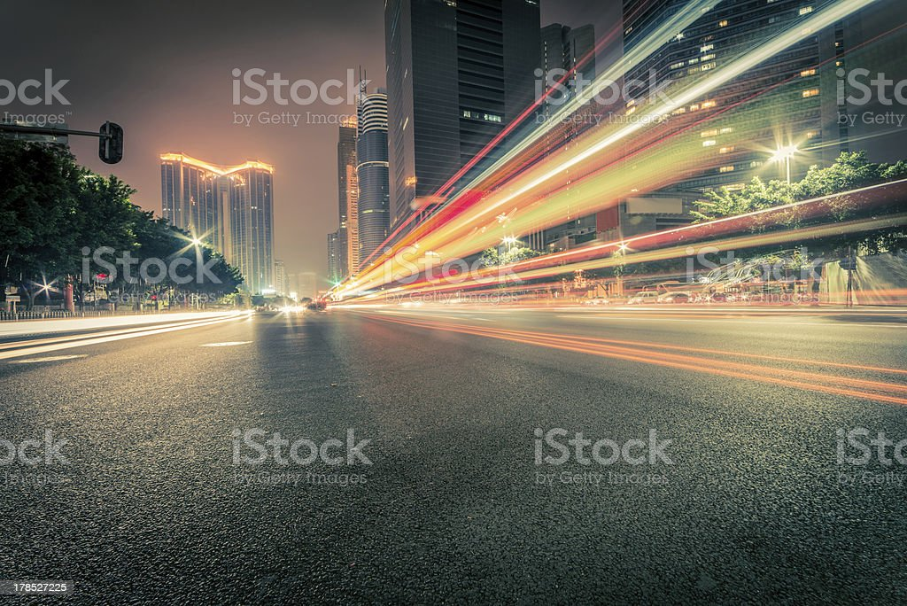 Traffic on a street at night stock photo