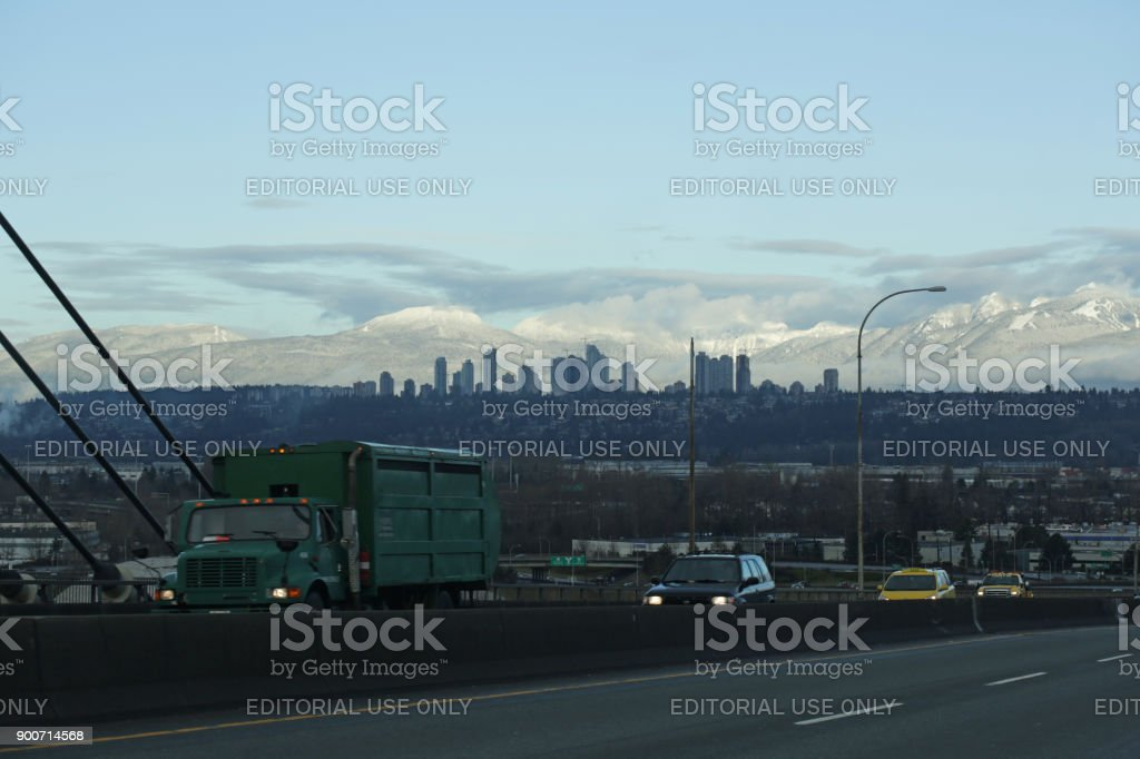 Traffic on Alex Fraser Bridge in Metro Vancouver, Canada, in Winter stock photo