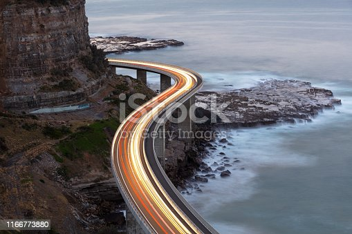 Car light trails on Sea Cliff Bridge, a balanced cantilever bridge located south of Sydney, New South Wales, Australia