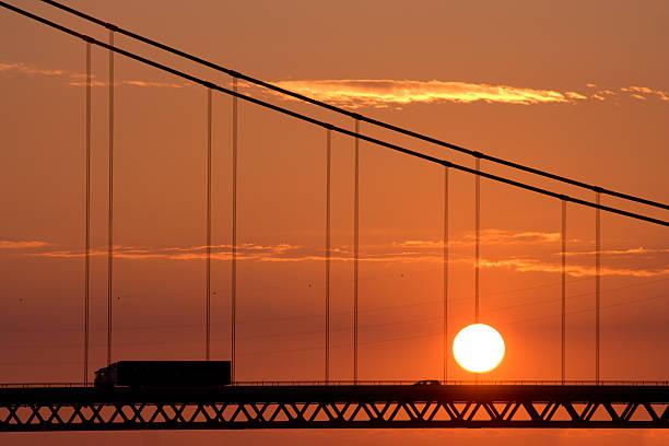 Traffic On Bridge With Sunset stock photo