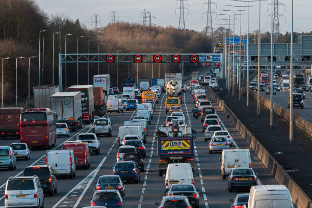 Traffic on British motorway M1 Watford, UK - March 08, 2018: Evening traffic jam on British motorway M1 multiple lane highway stock pictures, royalty-free photos & images