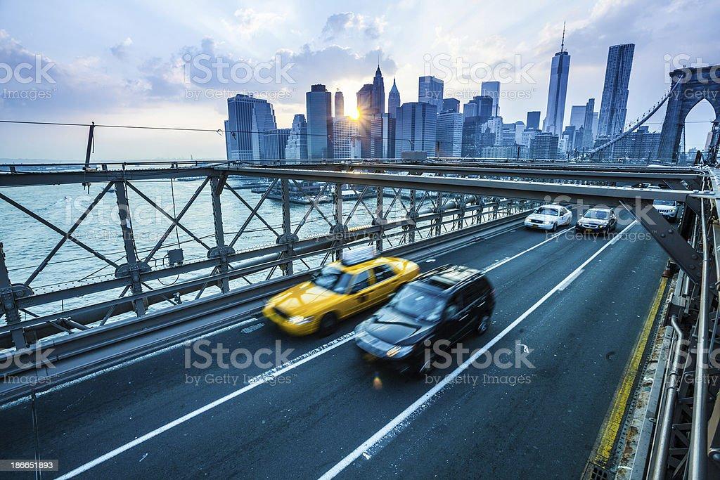 Traffic on Brooklyn Bridge and Downtown Manhattan stock photo