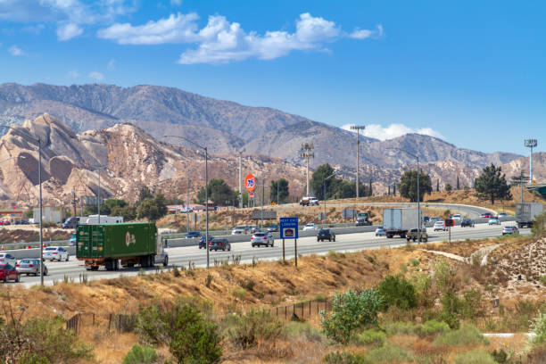Traffic on Interstate 15 through the Cajon Pass in San Bernardino County, California Phelan, CA, USA - September 4, 2018: Afternoon traffic on Interstate 15 through the Cajon Pass in San Bernardino County, California. Interstate 15 through the Cajon Pass is a major route from Los Angeles and the Inland Empire to Las Vegas. san bernardino california stock pictures, royalty-free photos & images