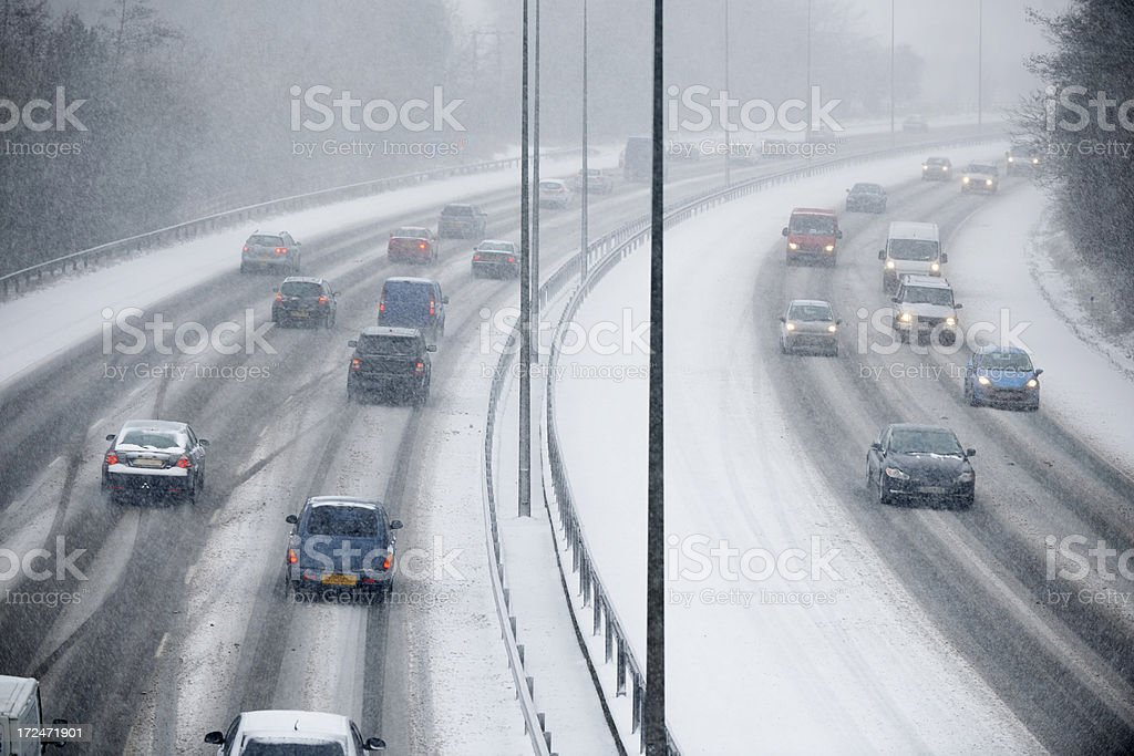 Traffic On Motorway During Snowstorm royalty-free stock photo