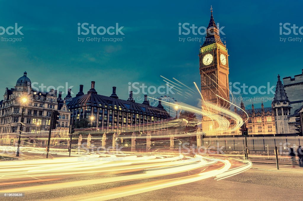 Traffic on Parliament Square near Big Ben in London stock photo