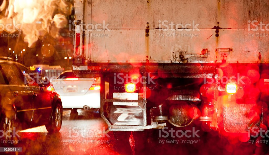Traffic on rainy night stock photo