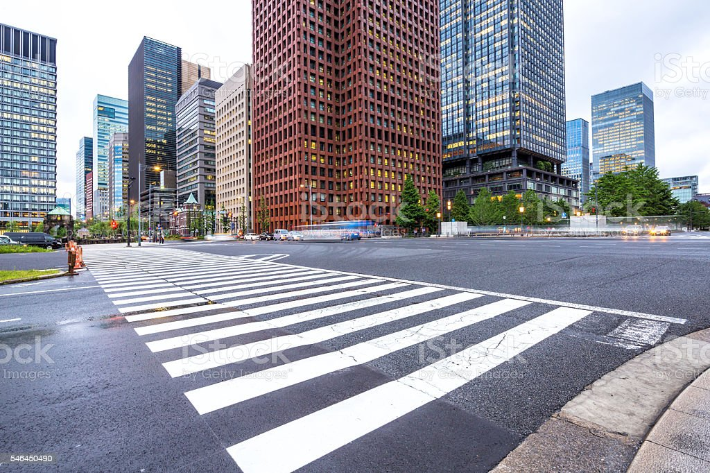 traffic on road intersection in downtown of tokyo stock photo