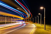 Light trails of traffic on road at night
