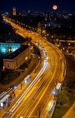 istock Traffic on Solidarity Avenue by night in Warsaw, Poland 1084024488