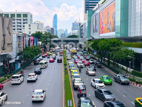 Traffic on Sukhumvit road, business area, Bangkok. View from BTS sky train, traffic before office time out.  Asian mega cities complicated traffic. Bangkok, Thailand