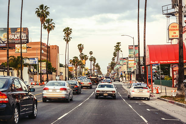 Traffic on Sunset Boulevard, Hollywood, Los Angeles Hollywood, Los Angeles, USA - May 8, 2013: Evening traffic on Sunset Boulevard, Hollywood, Los Angeles. sunset strip stock pictures, royalty-free photos & images