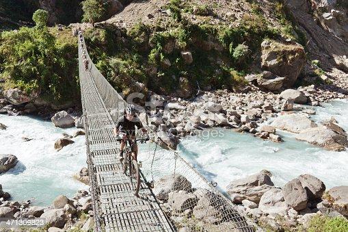 istock Traffic on suspension bridge, Nepal 471309823