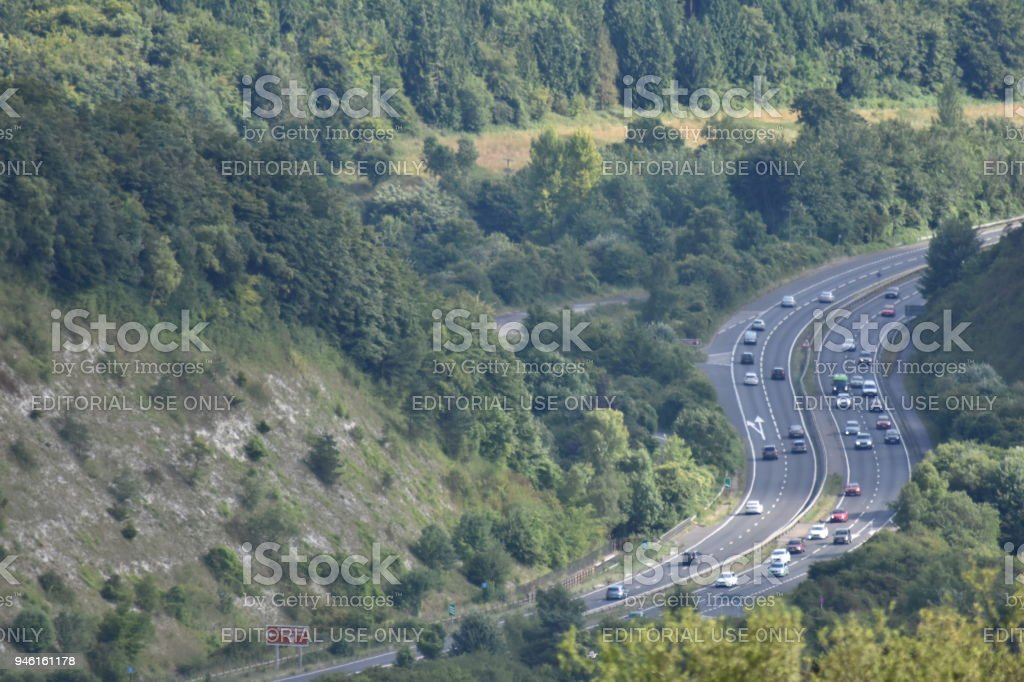 Traffic on the A3 trunk road through the Queen Elizabeth Country Park stock photo