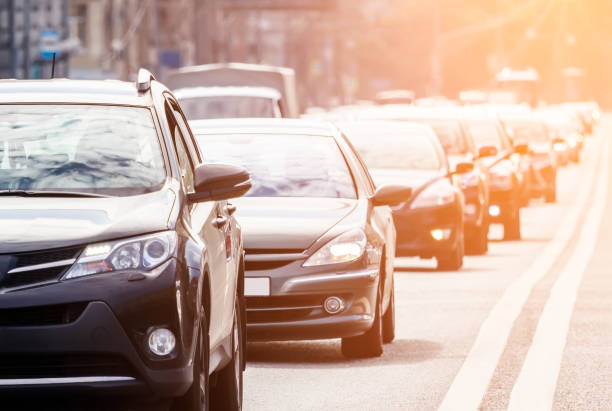 Traffic on the road with evening sun stock photo