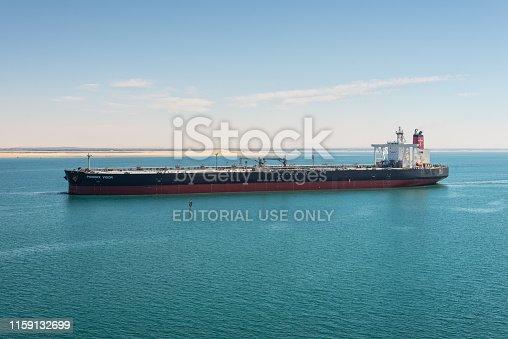 Suez, Egypt - November 5, 2017: Crude Oil Tanker Phoenix Vigor vessel passing the New Suez Canal near the Great Bitter Lake, Egypt, Africa.