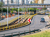 Bucharest/Romania - 05.16.2020: Traffic on Virtutii Boulevard, tram no.41 on tracks, cars, and a bridge in construction