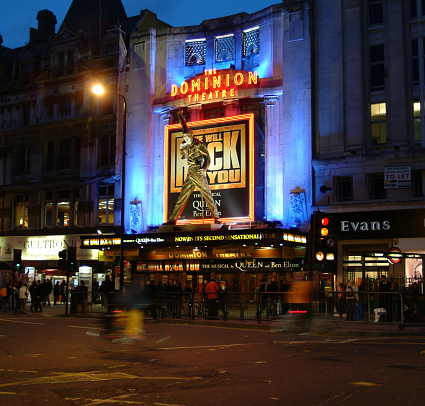 Traffic passes under the Statue of Freddie Mercury outside the Dominion Theatre during the run of Queen Musical We Will Rock You