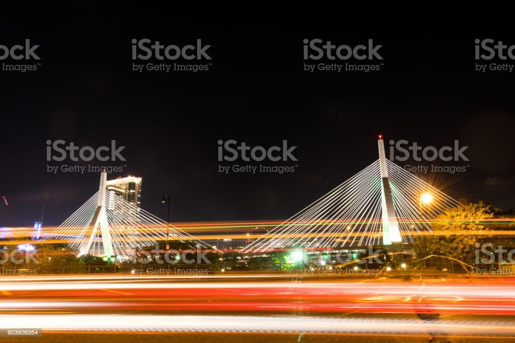 Traffic Passing Zakim Bridge at Night stock photo