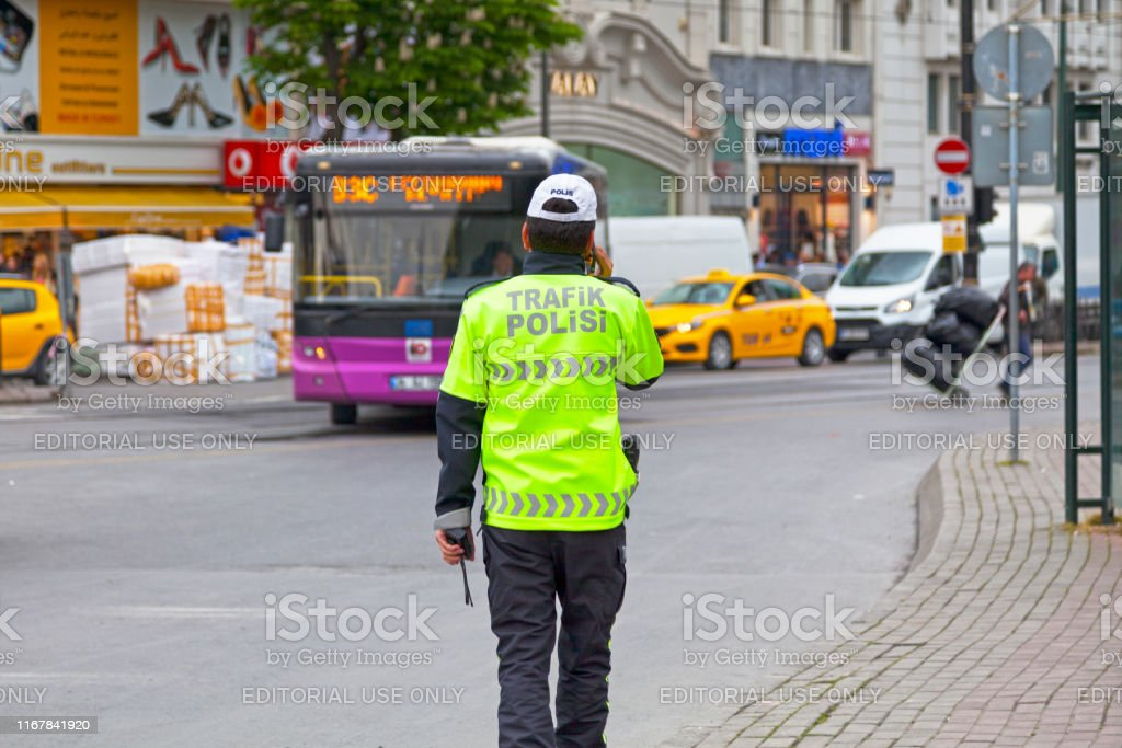 Traffic police in Istanbul Istanbul, Turkey - May 08 2019: Officer of the Trafik polisi (Traffic police) near the Bazaar. Horizontal Stock Photo