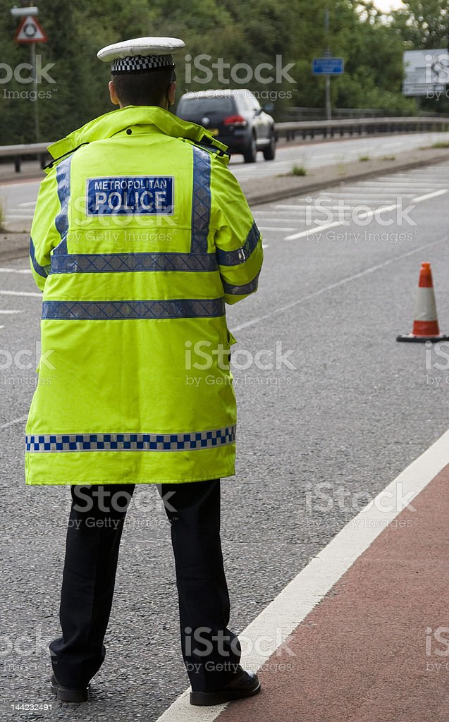 Traffic police man waiting on side of road stock photo