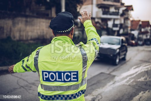 istock Traffic police pulling car over 1040459842