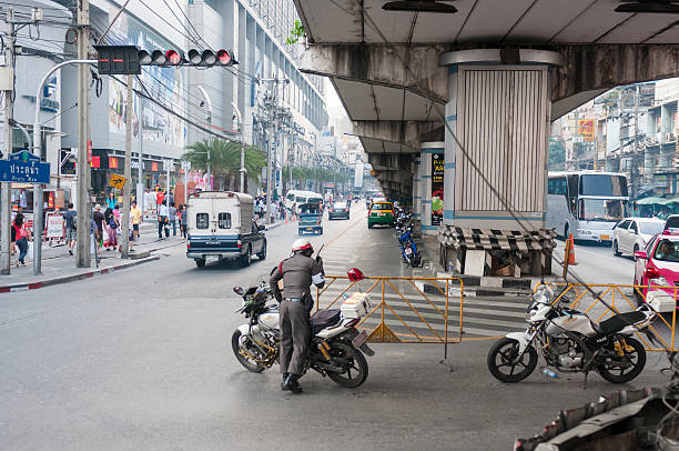 traffic policeman in bangkok, thailand - motorbike, umbrella stock pictures, royalty-free photos & images