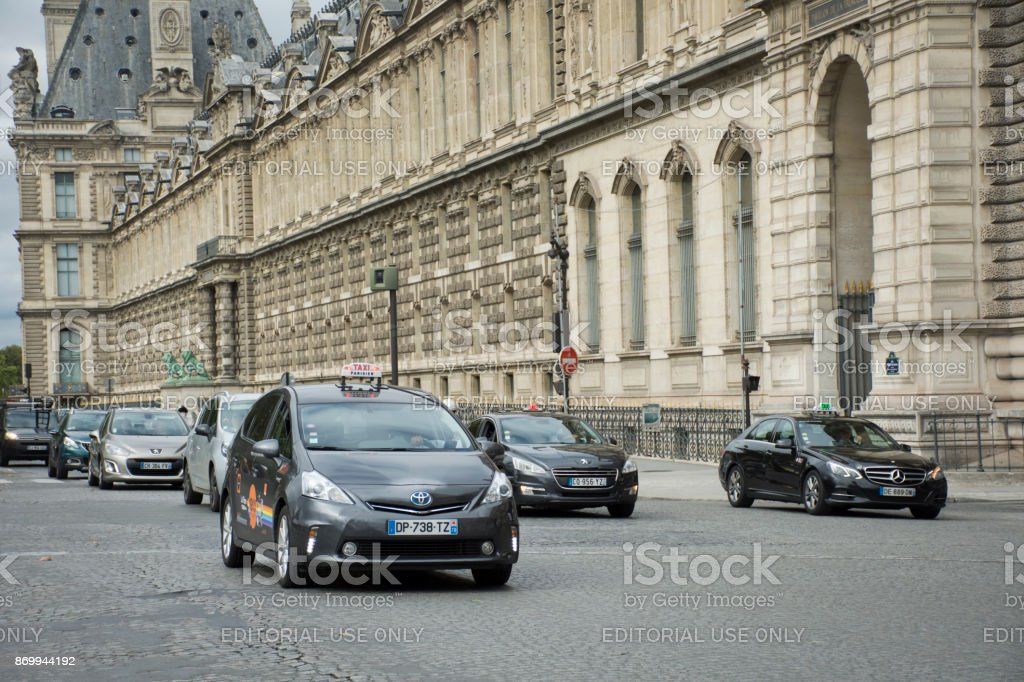 Traffic road and taxi on street in Paris, France stock photo