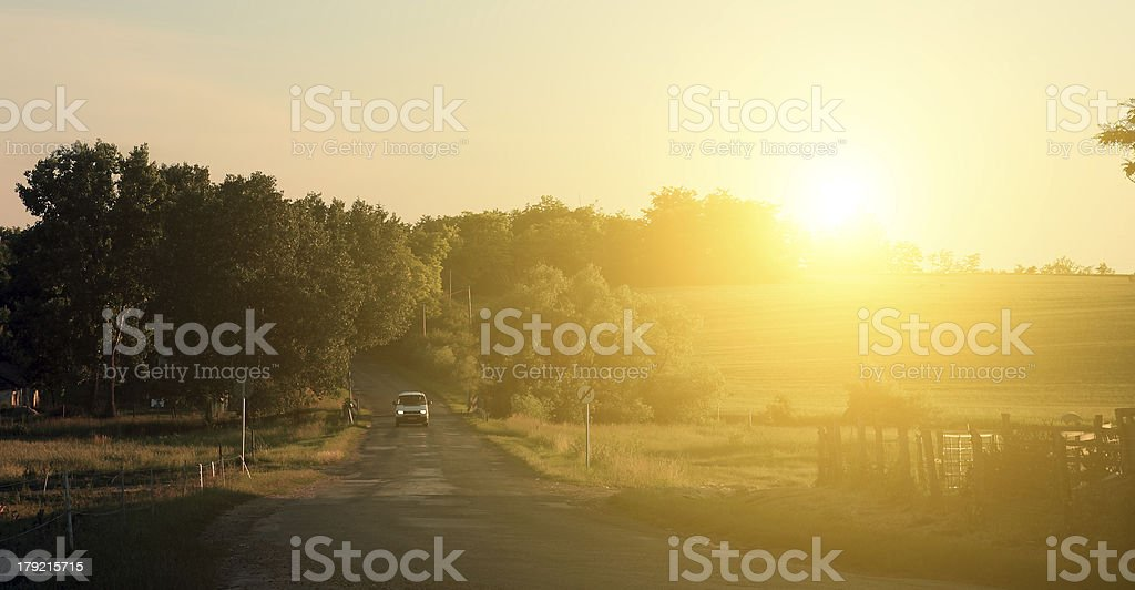 Traffic road with car in sunset royalty-free stock photo