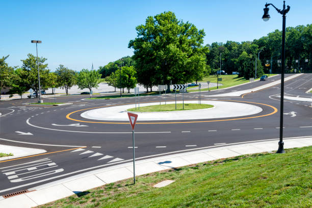 traffic roundabout intersection - kreisverkehr stock-fotos und bilder