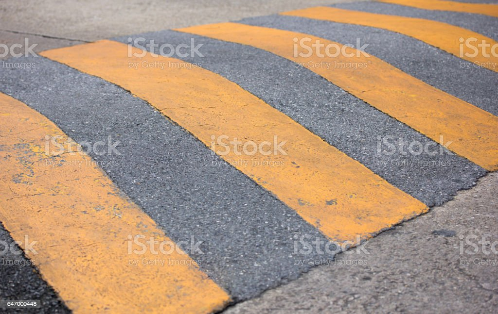 traffic safety speed bump on the road stock photo