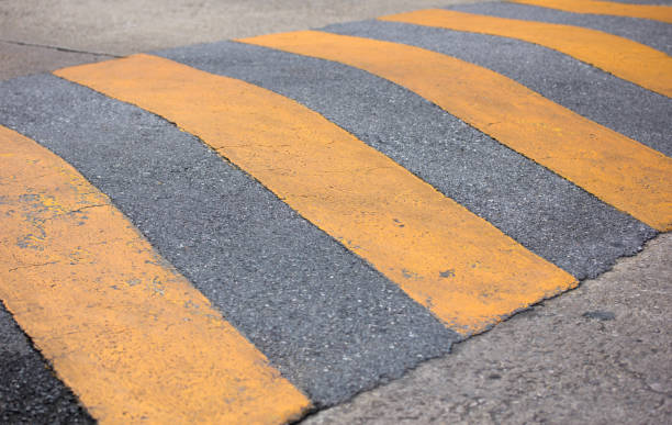 traffic safety speed bump on the road - bumpy stock pictures, royalty-free photos & images