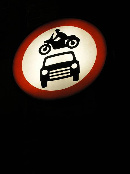 Traffic Sign At Night Lit traffic sign at night. skeable stock pictures, royalty-free photos & images