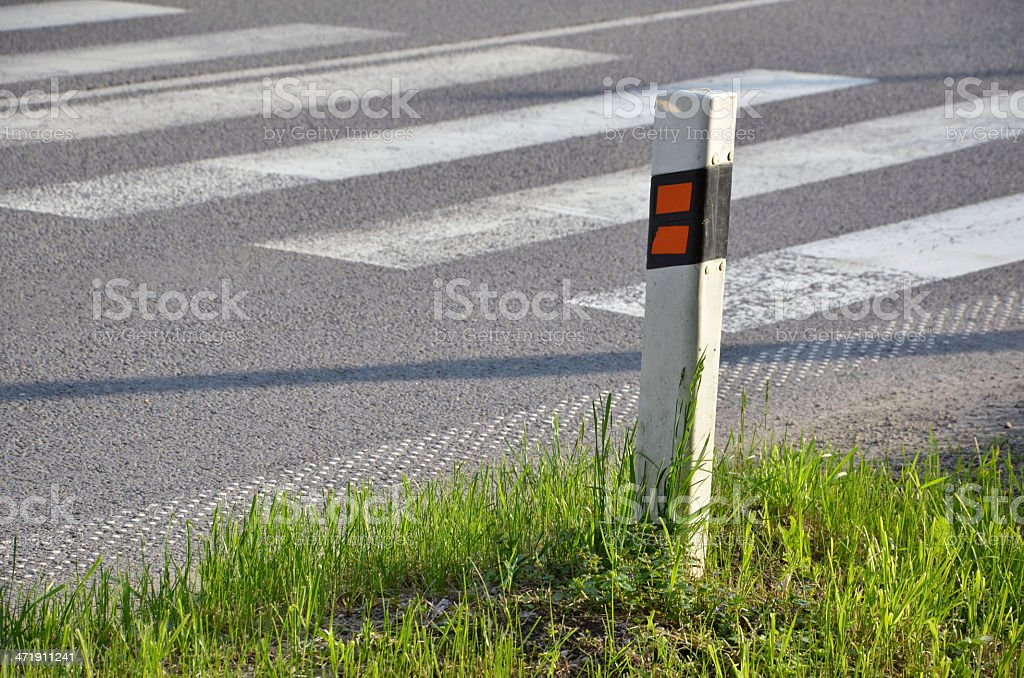 Traffic sign (delineator) determinate the edge of road stock photo
