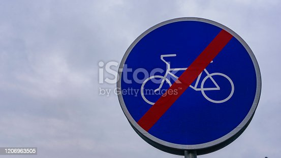 istock Traffic sign. Ends of zone for ride a bicycle. Background of dramatic sky. 1206963505