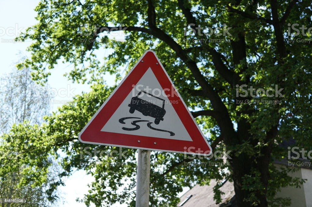 Traffic sign for slippery road stock photo