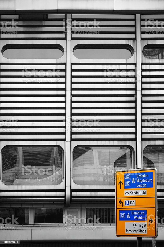 Traffic sign in front of metal facade stock photo